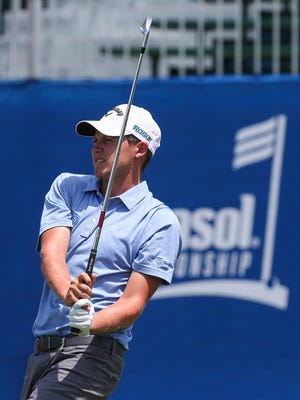 UK grad Cooper Mussleman of Louisville throws a little body English after he teed off from the 18th tee as he finished two under par Thursday in his first professional debut Thursday morning at the Barbasol Championship.
