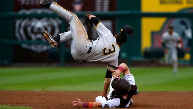 Iowa Hawkeyes Nick Roscetti goes airborne after a collision with Missouri State's Matt Fultz as he slid into second base in game six of the NCAA Division I Baseball Regional in Springfield, Mo. on Saturday, May 31, 2015.