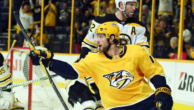 Nashville Predators right wing Craig Smith (15) celebrates after scoring past Boston Bruins goalie Anton Khudobin (35)  on Dec. 4, 2017.