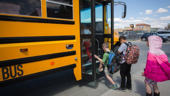 Central Elementary School students board a school bus after classes ended March 30, 2016. Bus service will be available Thursday. It's unclear how officials will handle transportation Friday, when there will be no collective bargaining agreement between a bus driver's union and the company contracted by Las Cruces Public Schools to provide bus service.