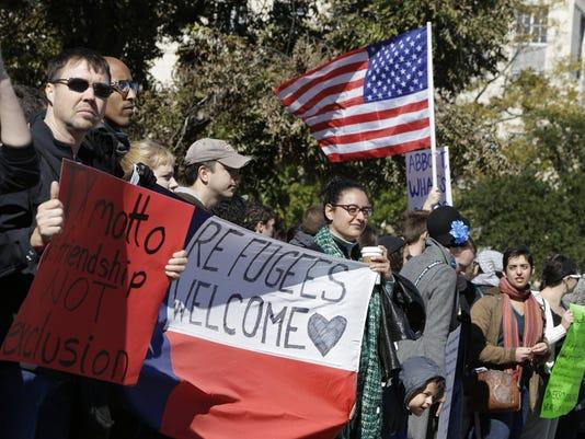 Activists Protest Against Texas Gov. Greg Abbott's Refusal Of Syrian Refugees