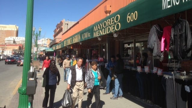 """Stores remain open Thursday on South El Paso Street as other areas of the country saw some shops and restaurants close for """"A Day Without Immigrants"""" to protest President Donald Trump's immigration policies."""