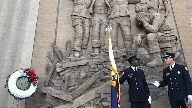 Memphis Fire Department color guard members Jason Tunstall and Jonathan Haley chat Sunday before the annual memorial service outside the Memphis Fire Museum.