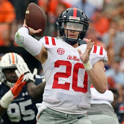 Mississippi quarterback Shea Patterson throws a pass