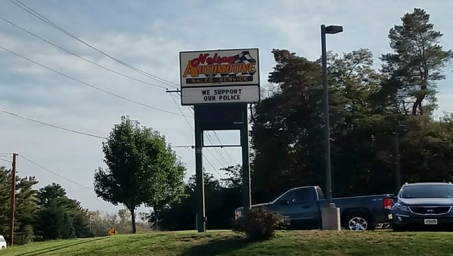 A business' sign in Polk City shows support for the police department on Oct. 7.