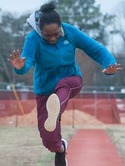 A member of the Wicomico High track team works on her triple jump during practice at Wicomico County Stadium on Friday afternoon.
