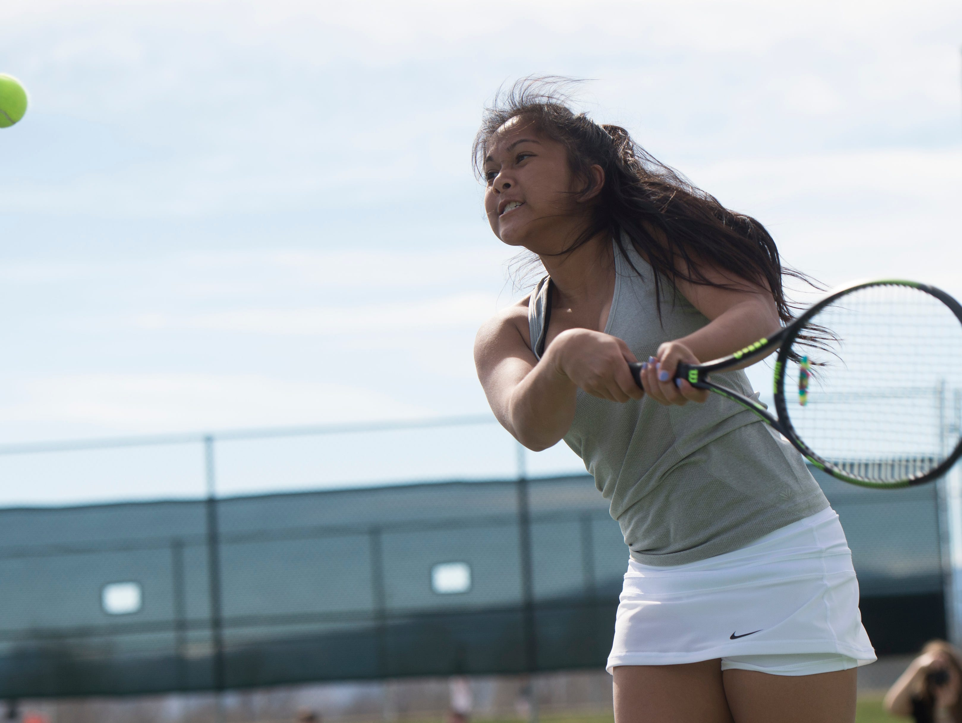 Shawnea Pagat of Fossil Ridge High School returns the ball to a Poudre tennis player during a match Wednesday, April 6, 2016.
