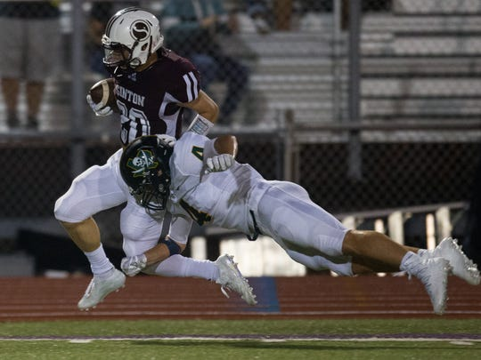Sinton's Colt Gorman is tackled by Rockport-Fulton's Cole Williams as he runs the ball during the fourth quarter of their game at Pirates Stadium in Sinton on Friday, Sept. 8, 2017.