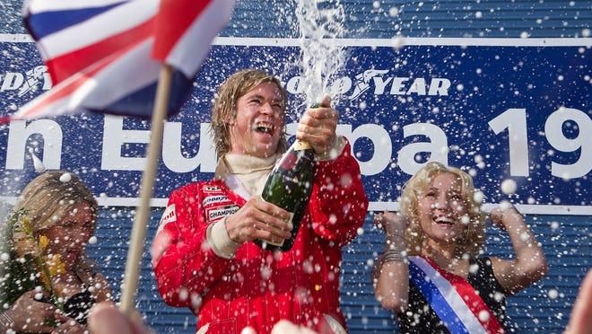 James Hunt (Chris Hemsworth) celebrates a racing victory in 'Rush.'