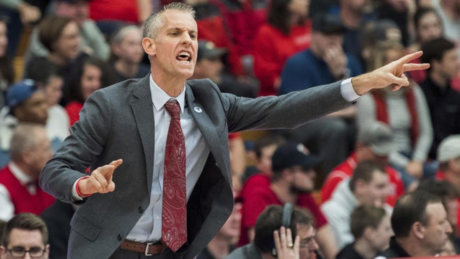 Gardner Webb coach Tim Craft sends in play against Radford during the first half of the Big South conference NCAA basketball championship game in Radford, Va., Sunday, March 10, 2019.