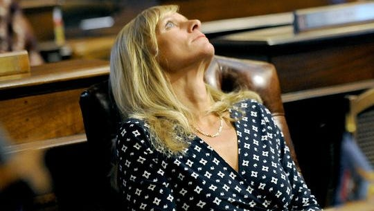 Michigan state Rep. Cindy Gamrat stares at the glass ceiling panels in the House of Representatives before the debate and vote on expelling Gamrat and Rep. Todd Courser on Thursday, Sept. 10, 2015. Gamrat was expelled from the legislative body. (Photo: Rod Sanford, Lansing State (Mich.) Journal)