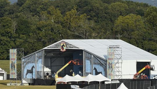 Workers build the main stage for the Pilgrimage Music & Cultural Festival at Harlinsdale Farm in Franklin. The event is set for Saturday and Sunday.