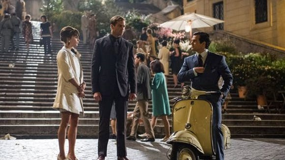 """Alicia Vikander, Armie Hammer and Henry Cavill appear in a scene from """"The Man from U.N.C.L.E."""""""