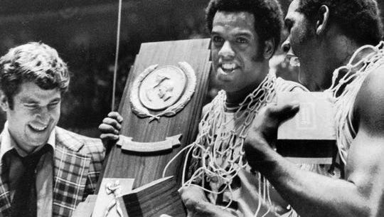 Quinn Buckner (right) celebrates with IU coach Bob Knight (left) and teammate Scott May after winning the NCAA championship in 1976.