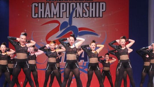 The Ankeny Centennial High School dance team performs its jazz routine at the National Dance Alliance National Championship in Orlando, Fla.