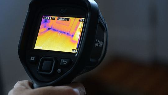 An infrared camera shows cold air coming in from under a door during an energy audit at the home of Barbra Libeler and Bill Jenkins on Thursday, November 19, 2015. Bolstering home energy efficiency is one of the city's key strategies for meeting its first greenhouse gas reductions goal.