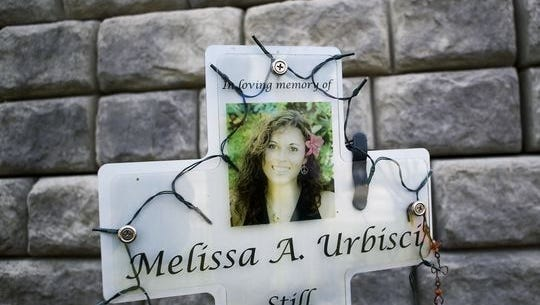 Melissa Urbisci's memorial at the intersection of Harrison Avenue and New Rybolt Road. Families will gather Sunday to light candles in an international wave of light in remembrance of lost children.