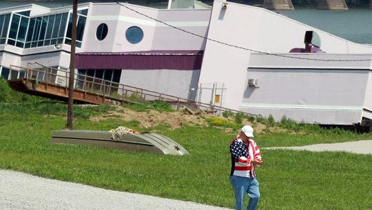 Owner Jeff Ruby walks away after looking at the partially sunken Waterfront Restaurant in 2014.