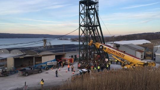 Rescue workers monitor the elevator shaft at Cargill Salt Mine in Lansing on Thursday. Seventeen mine workers were stuck in a shaft overnight