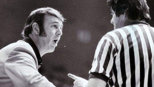 "Bobby ""Slick"" Leonard in 1975 having a few word with a referee."