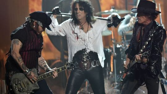 Hollywood Vampires (with Alice Cooper, center, on vocals) perform a Motorhead tribute at the Grammy Awards.