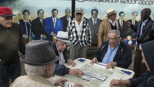 Cubans play dominos with their friends at Domino Park, also known as Maximo Gomez Park, in Little Havana.