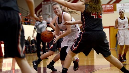 Nicole Mallory tries to get by a Romeo defender Monday, Feb. 29, during a district basketball game at Port Huron High.