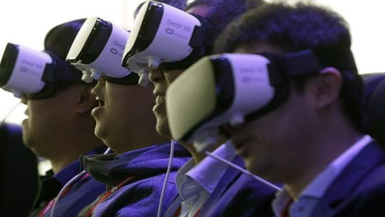 Users demo Samsung Gear VR headsets, which is set to dominate mobile VR this year, according to a new Deutsche Bank analyst report.