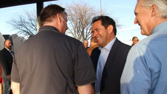 Lt. Governor John Sanchez greets people at the Roswell International Air Center after landing.