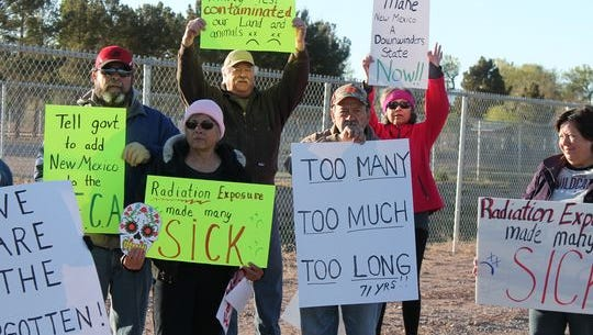 Tularosa Basin Downwinders peacefully protested outside of Tularosa High School before the caravan headed off to the Trinity Site Saturday morning. The Downwinders were raising awareness of the health issues many residents face.