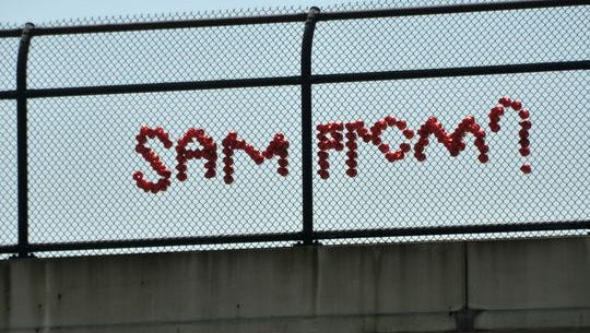 Some hopeful suitor/suitress has pinned their hopes in red cups on the Viera I-95 overpass, asking Sam to the prom.