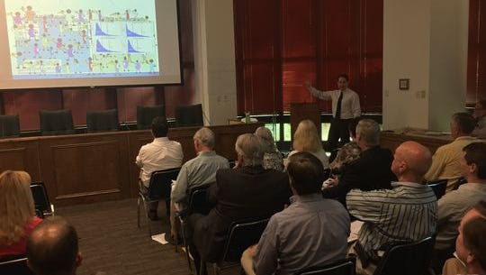 DEP officials unveil proposed new criteria for toxins in surface waters during a workshop Thursday in Tallahassee.