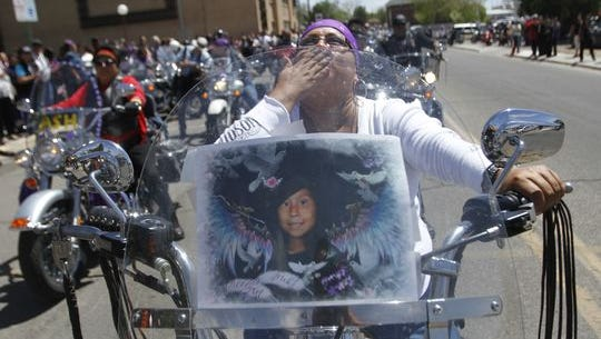 Lisa Tenorio, of Farmington, prepares to join hundreds of motorcyclists in escorting the body of Ashlynne Mike shortly after the 11-year-old's funeral service on May 6 at the Farmington Civic Center.