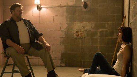 John Goodman, left, and Mary Elizabeth Winstead in a scene from '10 Cloverfield Lane'