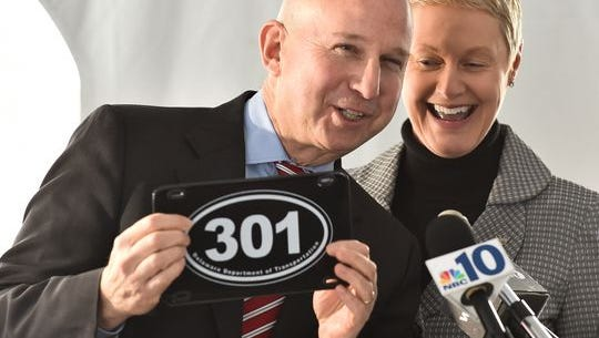 Gov. Jack Markell receives a 301 commemorative license plate from DelDOT Secretary Jennifer Cohan at the groundbreaking of the Highway 301 project in Middletown. The project is the most costly among the Wilmapco's list of capital projects for the next three years.