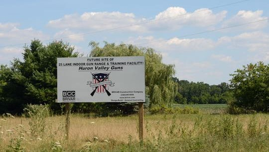 A sign along Milford Road near I-96 at the site where Huron Valley Guns planned to break ground.