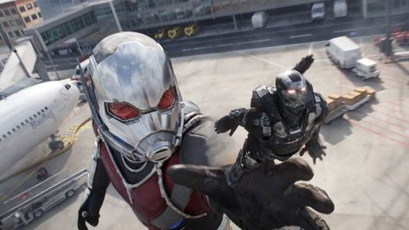"""In this scene from """"Captain America: Civil War,"""" Giant-Man reaches for War Machine."""
