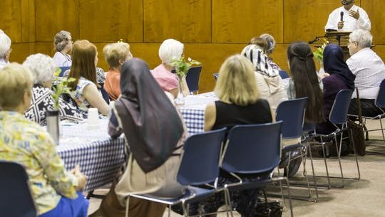 M.A. Muqtedar Khan speaks at an interfaith dinner and discussion at the Westminster Presbyterian Church in Wilmington in June. Church members say they are eager to help refugees from Syria of any faith settle in Delaware, but so far none have arrived.