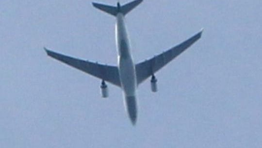 A plane flies over the home of Don Heithaus in Rye Brook on Sept. 20. He is chairman of the Westchester County Airport Advisory Board and an outspoken critic of County Executive Rob Astorino's proposal to relax passenger limits at the airport.