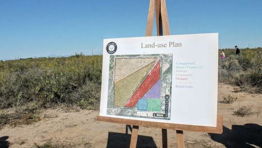 The sustainable housing community design plan was displayed at the lot where the future community will be built Friday morning.