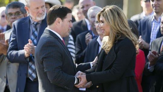 Gov. Doug Ducey shakes hands with the governor of Sonora, Mexico, Claudia Pavlovich Arellano, at the Arizona state Capitol in Phoenix on Nov. 29, 2016. Parts for Lucid Motors' electric vehicles would be manufactured by suppliers in Sonora.