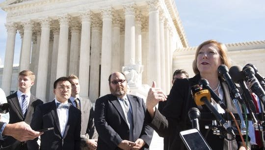 Samsung's attorney, Kathleen Sullivan, answers questions outside the U.S. Supreme Court following oral arguments.