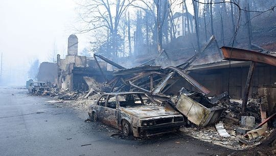 Wildfires have burned multiple businesses and vehicles such as these along Cherokee Orchard Road in Gatlinburg.