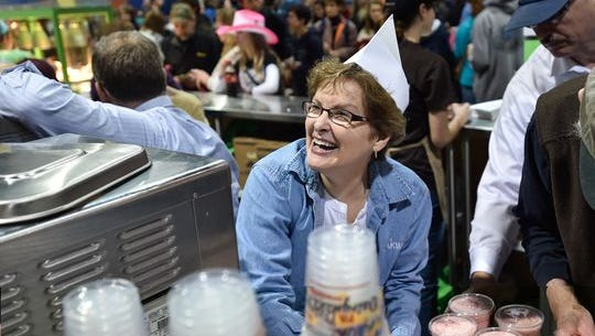 Nancy Martin smiles as she makes shakes inside the Milk Shake stand at the 100th Pennsylvania Farm Show in Harrisburg, Pa. on Saturday, Jan 9, 2016. .