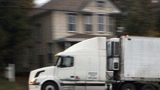 A tractor-trailer passes a house on Del. 41 in 2015. Residents who live along the road have been petitioning the state to direct heavy trucks away from their neighborhood.