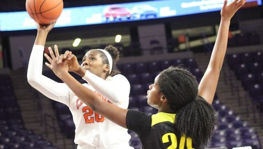 Clemson post player Sirah Diarra (20) attempts a shot while being defended by Oregon forward Ruthy Hebard (24) in a recent game at Littlejohn Coliseum.