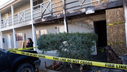 Plywood covers the doors of burned units at the Villa View Apartments in Farmington on Wednesday.