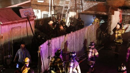 Firefighters work at a Canby Park rowhouse at 3 a.m. Sept. 24. Two firefighters were killed and four were injured. (Photo: WILLIAM BRETZGER/THE NEWS JOURNAL)