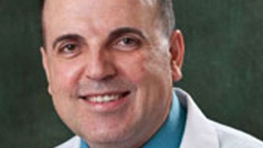 A Miami-based hospice agency on Wednesday, Nov. 30, 2016, denied paying kickbacks to convicted cancer doctor Farid Fata. VISTA Healthcare said paid the federal government $200,000 to settle those claims, but that it didn't do anything wrong.
