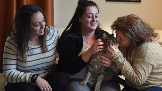 Taylor, 26, Paige, 23, and Susan Zelitsky give love to Jimmy, the family pet for years, on Tuesday, after his return to their Wanaque home.